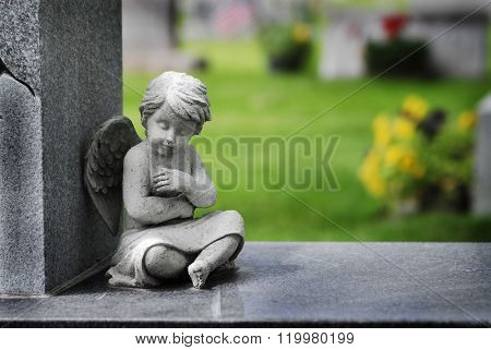 Cherub angel statue with wings carved from granite stone religious symbol brining hope and love