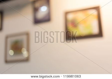Abstract Blurred Photo Frame Hanging On White Wall, Decoration Interior In Restaurant