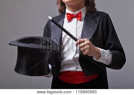 Magician Holding Magic Hat And Wand
