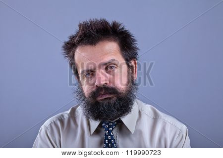 Exhausted Man With Bushy Hair And Beard