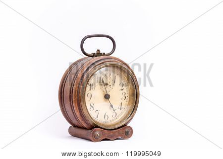 Alarm clock. Old and vintage clock. Isolated on white background.