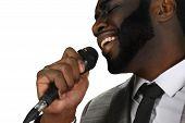 Darkskinned singer perfrorming. Live singing perfrormance. Black man is singing. Perfromer at his best. poster