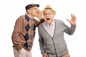 Senior man whispering something to his friend and laughing together isolated on white background poster