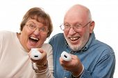Happy Senior Couple Play Video Game with Remote Controls. poster
