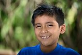 Headshot of latino boy with smile in nature poster