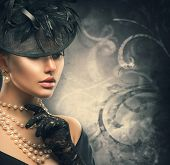 Retro Woman Portrait. Vintage Style Girl Wearing Old fashioned Hat, gloves, pearls necklace and earrings, retro Hairstyle and Make-up. Romantic lady over black background. Pearl Jewellery poster
