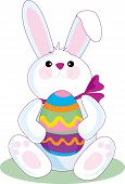 the easter bunny holding a big easter egg poster