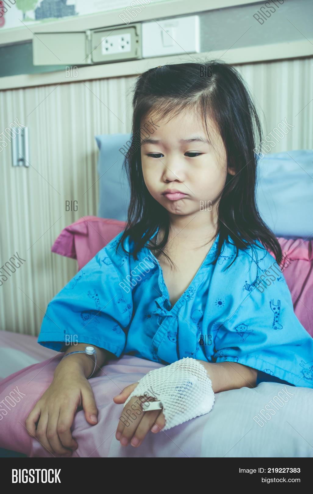 Illness Asian Child Image & Photo (Free Trial) | Bigstock