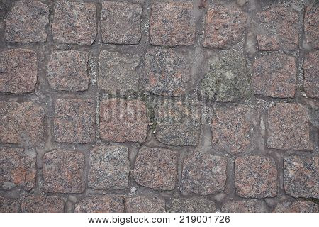 Dry dusty rectangular granite setts from above