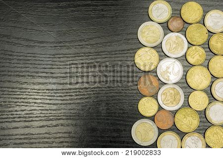 Euro coins in various denominations on the table.