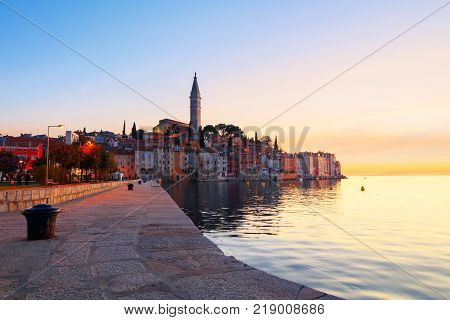 Sunset at medieval town of Rovinj colorful with houses and church in Croatia