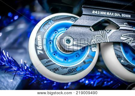 BANGKOK THAILAND - DECEMBER 16: White 76mm silicon roller blade wheel by BKB mounted on a skate with blurred background.