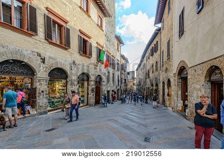 San Gimignano Italy - September 24 2016: Tourists are walking in the famous town San Gimignano in tuscany Italy