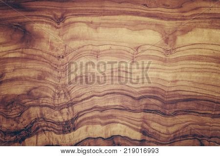 Close up yellow and brown pattern of olive wood woodgrain texture background with old vintage retro colors