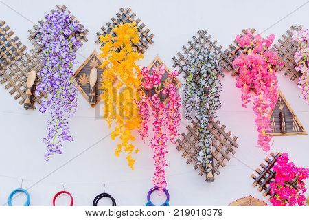Colorful decorative wall hangings handicrafts on display with white background during the Handicraft Fair in Kolkata - the biggest handicrafts fair in Asia.