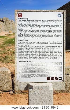 Hampi, India - November 20, 2012: Signpost for tourists about platform of Mahanavami Dibba in Hampi, Karnataka, India.
