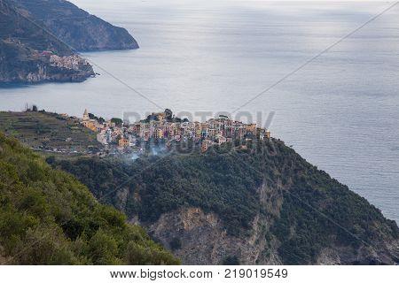 The towns of Corniglia and Manarola overlooking the Ligurian Sea in Cinque Terre Italy.