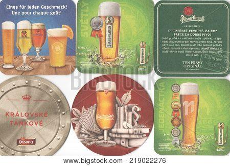 PRAGUE CZECH REPUBLIC - DECEMBER 20 2017: Beermats (bierdeckel) background. Various beer trademarks