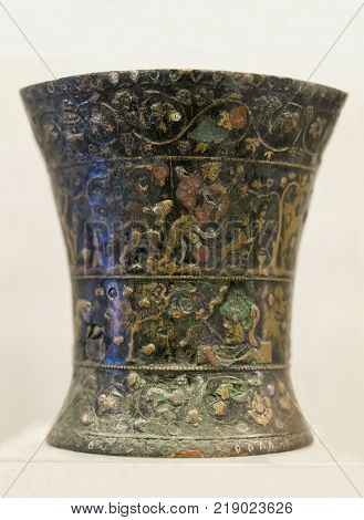 Badajoz Spain - November 21 2017: Nertobriga vase. Bronze vessel and silver niello beautifully decorated with Bacchic scenes. Badajoz Archeological Museum