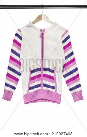 Knitted pink and white sport jacket on wooden clothes rack isolated over white