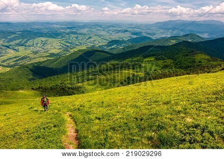 footpath down the hillside in to the valley. beautiful mountainous landscape in summertime. summer outdoors activity concept. location mountain Pikui TransCarpathia Ukraine