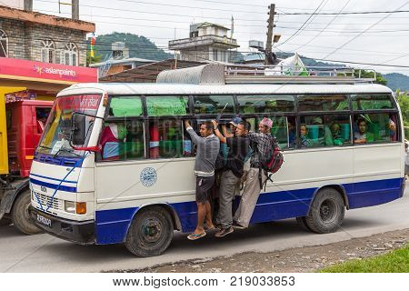 POKHARA NEPAL OCTOBER 02 2013: Local bus on the street to Pokhara Nepal. Transportation on the road in Pokhara.