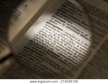 CLECKHEATON, WEST YORKSHIRE, UK: MAGNIFYING GLASS ON DICTIONARY PAGE SHOWING DEFINITION OF THE WORD ATMOSPHERE, CIRCA 2006, CLECKHEATON, WEST YORKSHIRE, UK
