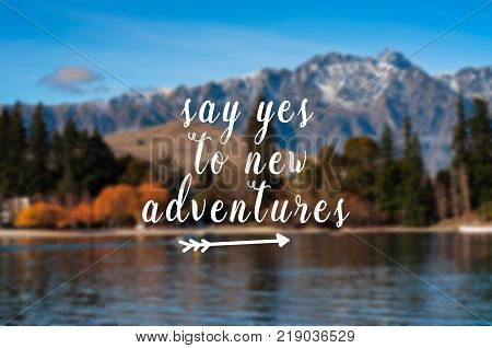 Inspirational quote - Say yes to new adventures. Blurry background.