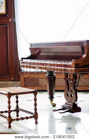 Classic grand piano. Royal piano in hall interior