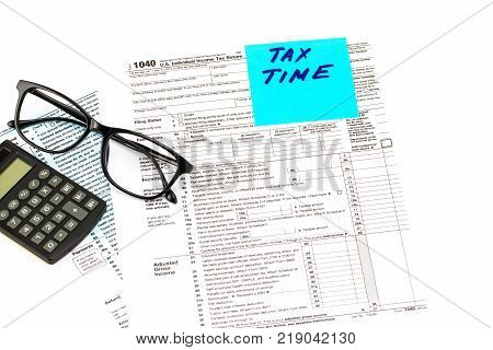 Tax Time Written On Chalkboard With Money And Alarm Clock On White Background