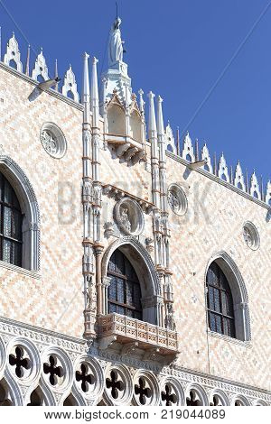 Doge's Palace on Piazza San Marco Goddess of Justice statue at the top Venice Italy.The palace was the residence of the Doge of Venice the museum is currently located here