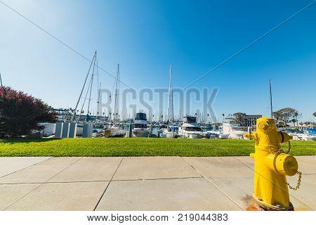 Yellow hydrant on a walk path in Oceanside California