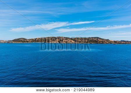 Rocky shore il La Maddalena seen from the sea. Sardinia Italy