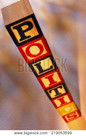STACK OF WOODEN TOY BUILDING BLOCKS SPELLING THE WORD POLITICS