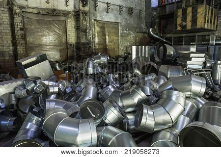 Steel pipes in warehouse of factory for manufacturing and production of industrial air condition systems, toned