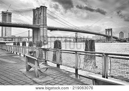 HDR view of Brooklyn Bridge and Manhattan Bridge - black and white image.