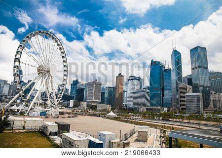 HONG KONG -APR 4, 2016: Ferris Wheel in Hong Kong at sanny day n Apr 4, 2016. The Hong Kong Observation Wheel is located in Central, Hong Kong.