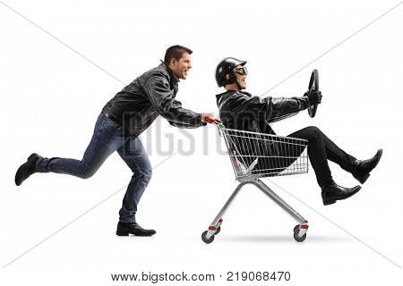 Biker pushing a shopping cart with another biker holding a steering wheel and riding inside isolated on white background