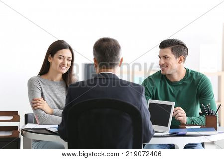 Young couple at notary public office