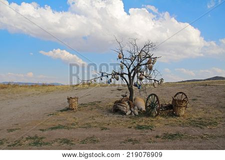 Goreme Turkey - August 14 2017: Tree Of Wishes with clay pots in Cappadocia. Nevsehir Province Cappadocia Central Anatolia Turkey