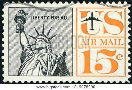 UNITED STATES OF AMERICA - CIRCA 1959: post stamp printed in USA shows statue of liberty; liberty for all; air mail; Scott C58 AP39 15c black orange, circa 1959