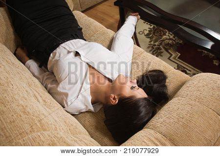 Strangled Beautiful Business Woman Lies On The Floor.