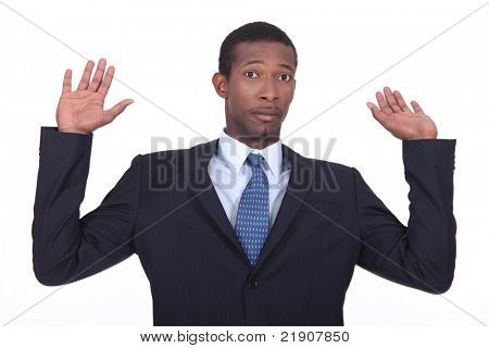 Businessman in a suit holding his hands in the air