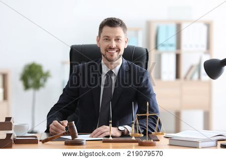 Young male notary working in office