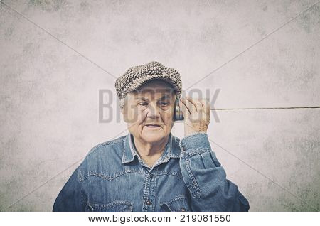 Portrait of a senior woman hearing with metal tin. Age-Related Hearing Loss concept.