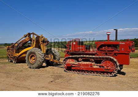 ROLLAG, MINNESOTA, Sept 3. 2017: An International Turbo red restored bulldozer pulls an earth scraper at the annual WCSTR farm show in Rollag held each Labor Day weekend where 1000's attend.