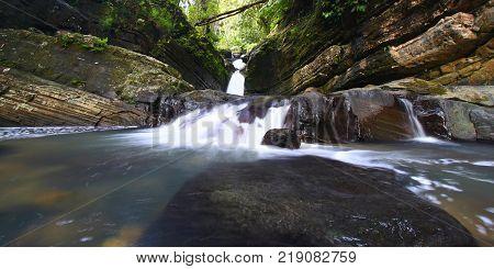 Tranquil rainforest cascade above La Mina Falls in Puerto Rico