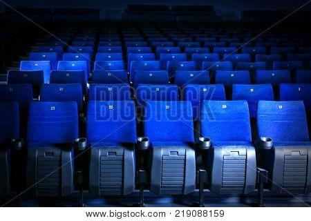Comfy blue seats in empty cinema hall