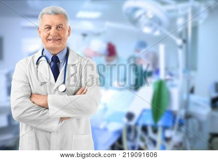 Owner of business in his private clinic