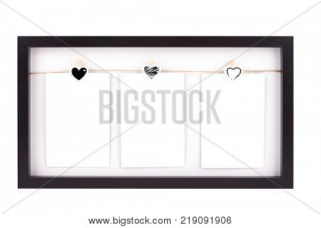 Wooden picture frame with three photos, isolated on white with clipping path
